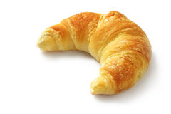 Croissant. Single fresh croissant, casting soft whadow on white.  Delicious Royalty Free Stock Photography