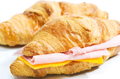 Croissant. With ham and cheese isolated on white background Stock Images