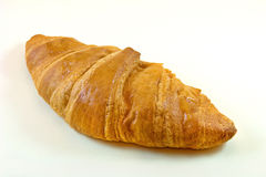 Croissant. Fresh croissant on white background Royalty Free Stock Photos