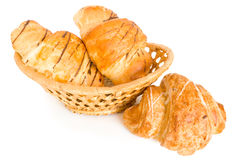 Croissant. Single fresh croissant in a basket, casting soft whadow on white Royalty Free Stock Photos
