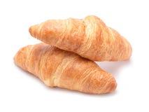 Croissant aislado en el fondo blanco fotos de archivo