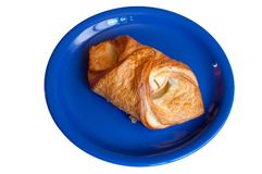 Croissant with apples on blue plate Royalty Free Stock Image