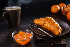 Croissant and apricot jam Royalty Free Stock Photo