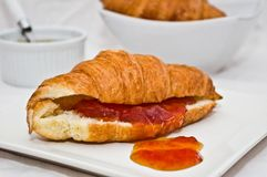 Croissant with apricot jam. Coissant with apricot jam, for a delicious breakfast Royalty Free Stock Images