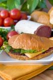Croissant avec le salami et le fromage Photos libres de droits