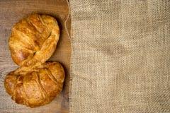 Croissant bakery on burlap teak wood table Stock Image