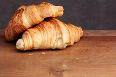 Croissant bakery on teak Stock Photos