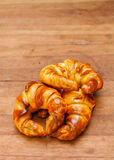 Croissant bakery on teak wood table Royalty Free Stock Image