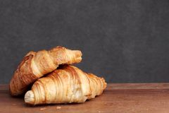 Croissant bakery on teakwood Royalty Free Stock Photos