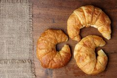 Croissant bakery on teakwood table Royalty Free Stock Photography