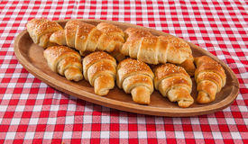 Croissant bakery on teakwood table on red and white fiber backgr Stock Photography