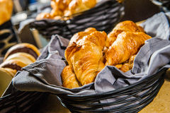 Croissant on the basket. Stock Photo