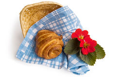 Croissant with a basket and flowers Royalty Free Stock Photography