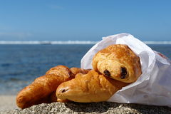 Croissant on the beach Royalty Free Stock Image