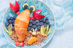 Croissant with berries for funny kids breakfast. Funny Lobster Croissant with berries for kids breakfast royalty free stock images
