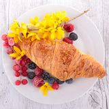 Croissant and berries Stock Images
