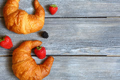 Croissant with berries on wooden boards Stock Photography
