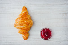Croissant and berry jam on the table top view Stock Image