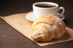 Croissant and black coffee Stock Image