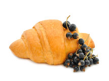 Croissant with black currant Royalty Free Stock Images