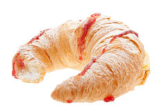 Croissant with blancmange cream. Stuffed, strawberry jam and dust sugar royalty free stock images