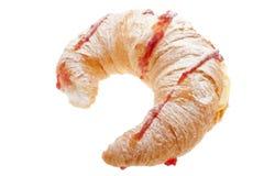 Croissant with blancmange cream. Stuffed, strawberry jam and dust sugar stock image
