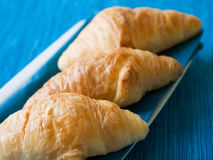 Croissant with blue background Stock Image