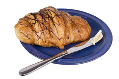 Croissant on blue dish Royalty Free Stock Photo