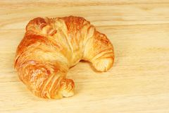 Croissant on bread board royalty free stock photography