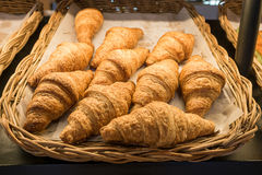 Croissant bread on buffet line, fresh croissants on wicker basket Stock Images