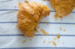 Croissant ,Bread crump on tablecloth Stock Images
