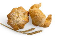 Croissant and bread roll with stems of wheat Stock Image