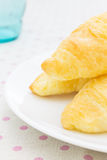 Croissant or Bread on White Dish on placemat with Glass Close Up Royalty Free Stock Photography