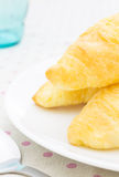 Croissant or Bread on White Dish on Placemat with Spoon and Glas Stock Photography