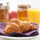 Croissant breakfast. Croissant on a napkin, shallow deep of field Royalty Free Stock Photo