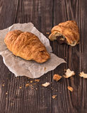Croissant for breakfast on a dark wooden table Royalty Free Stock Images