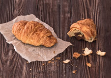 Croissant for breakfast on a dark wooden table Royalty Free Stock Photo