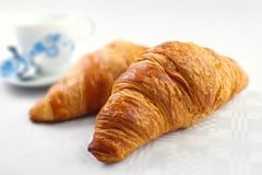 Croissant breakfast. Fresh croissant breakfast with coffee cup on background Royalty Free Stock Image