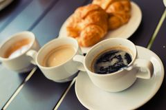 Croissant Breakfast served with black coffee and breakfast menu. Stock Images