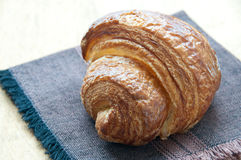 Croissant on a brown napkin royalty free stock photos