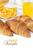 Croissant bun with orange juice Royalty Free Stock Images