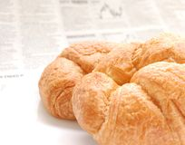 Croissant and business paper. Croissant over business paper with graphs out of focus, macro Royalty Free Stock Images