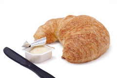 Croissant With Butter Royalty Free Stock Photography
