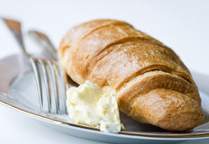 Croissant with butter Stock Photography