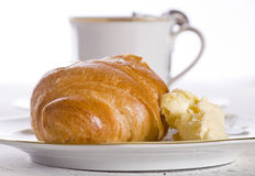 Croissant with butter and coffee Royalty Free Stock Photography