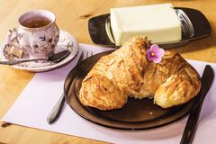 Croissant, butter and coffee for breakfast Stock Images