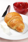 Croissant with butter and jam Royalty Free Stock Image