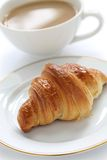 Croissant and cafe au lait. French breakfast on a white background Stock Photos
