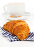 Croissant with caffee cup. Royalty Free Stock Photography