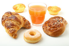 croissant cake donuts and orange juice Royalty Free Stock Photography